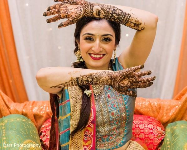 Maharani at her mehndi celebration showing her henna art.