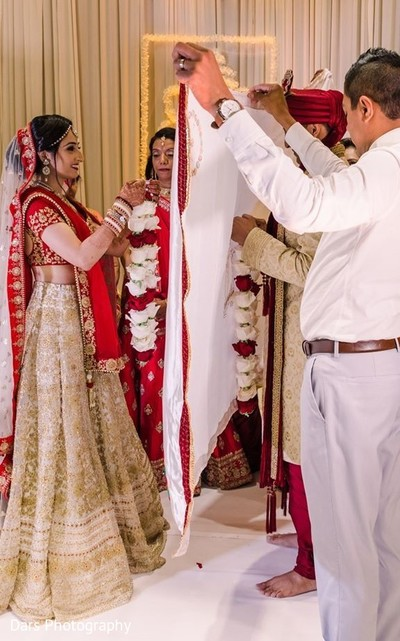 Indian bride and groom divided by antarpat.