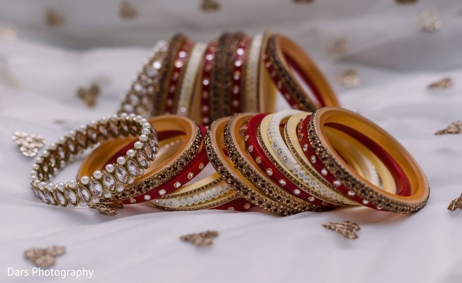Red white and golden Indian bridal ceremony bangles.