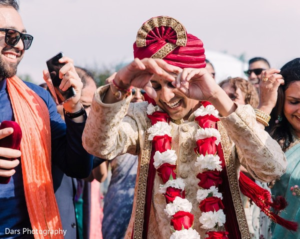 Indian groom dancing at baraat.
