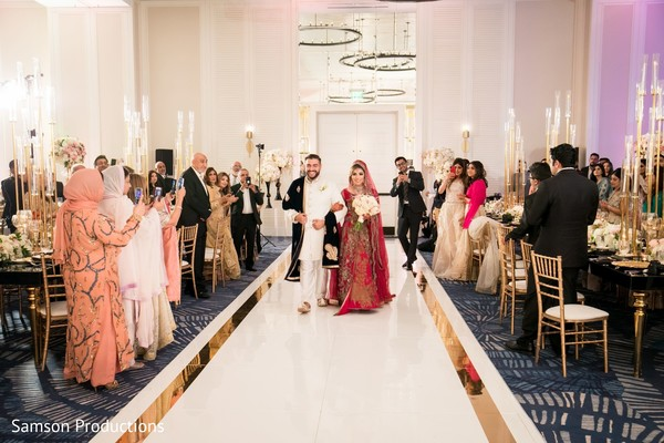 Newlywed Indian couple's entrance at the wedding dinner hall