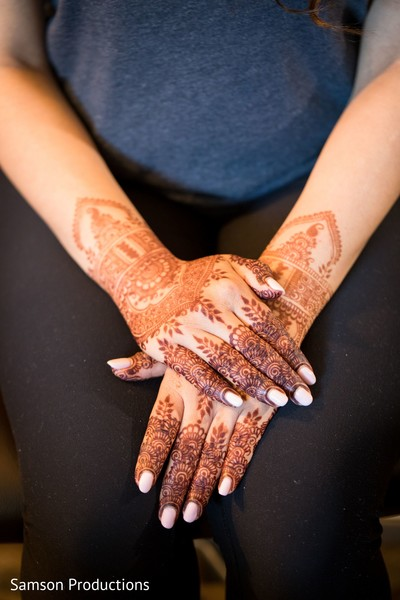 A close up to Maharani's henna stained hands