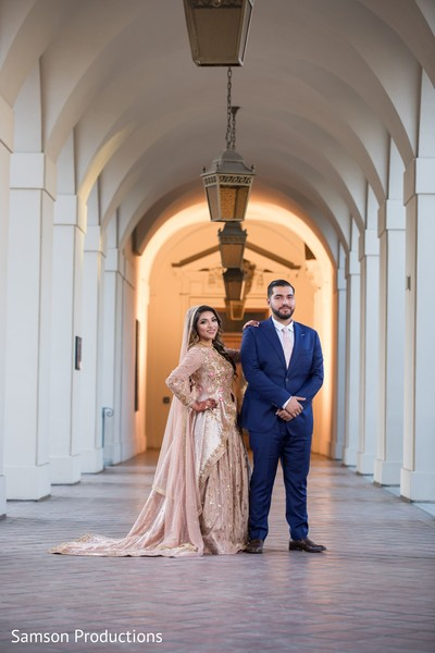 Indian newlyweds posing in one of the venue halls