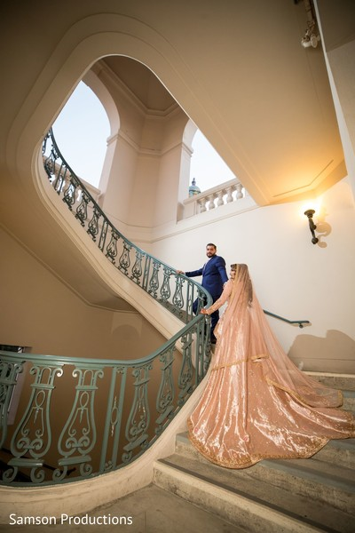 Indian newlyweds going upstairs