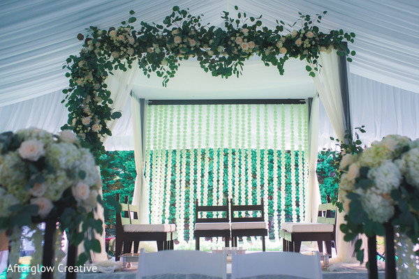 White and pale pink roses decorations for Indian wedding mandap.