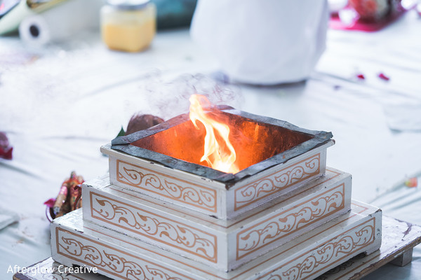Indian wedding ceremony  white and golden sacred fire table.