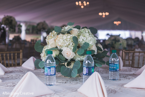 White and pale pink Indian wedding table centerpiece.
