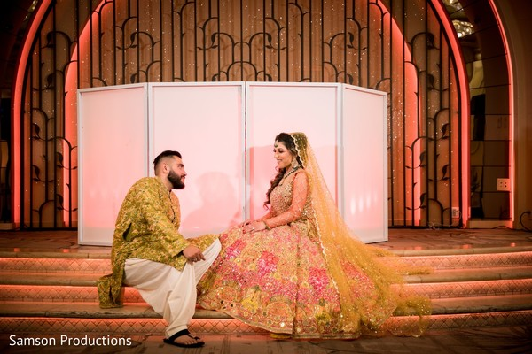 Indian couple sitting on the stage steps