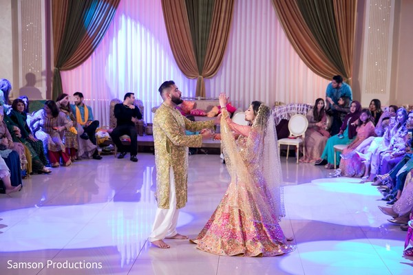 Indian couple dancing under a blue light