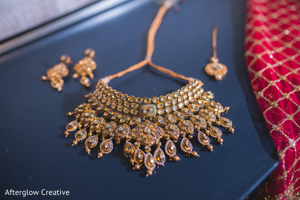 Indian bridal ceremony kundan necklace, tikka and earrings.