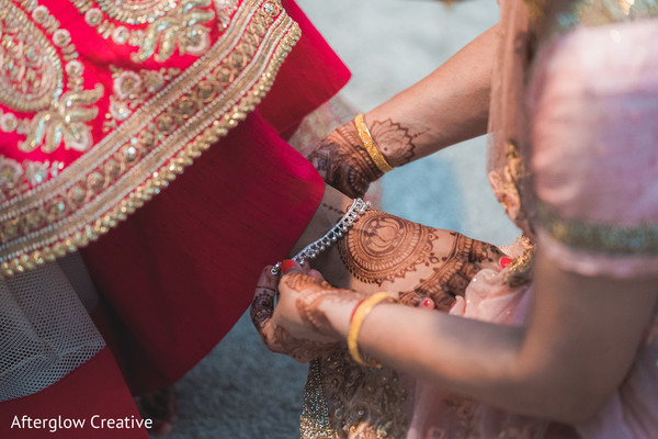 Maharani getting her anklets on.