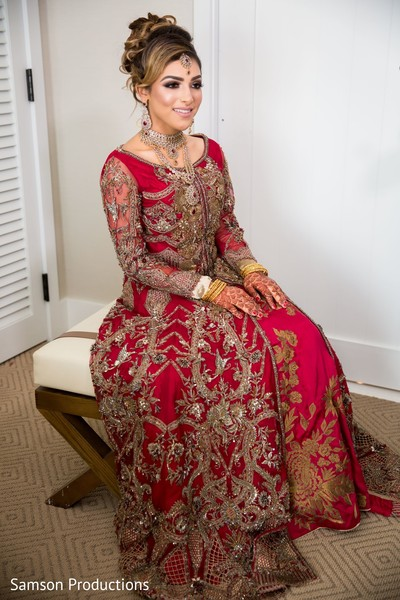 Indian bride sitting in the preparation room