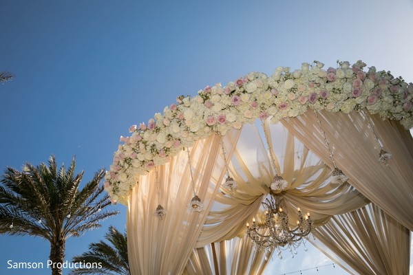 The decorated top of the wedding stage with the blue sky as background