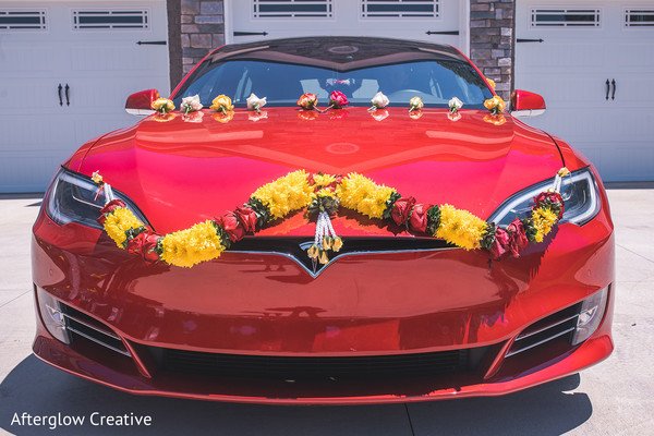 Yellow and red Indian wedding flower lasso decorating vehicle.