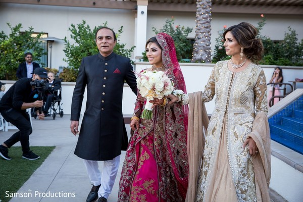 Indian bride and her Indian relatives about to walk down the aisle