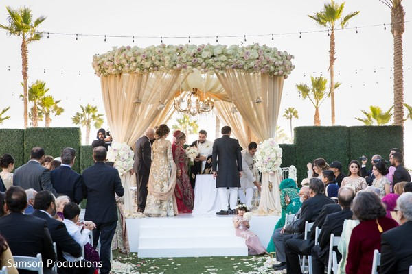 Indian bride, Indian groom and Indian relatives on the wedding stage