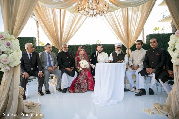 Maharani and her Indian groom sitting on the wedding stage