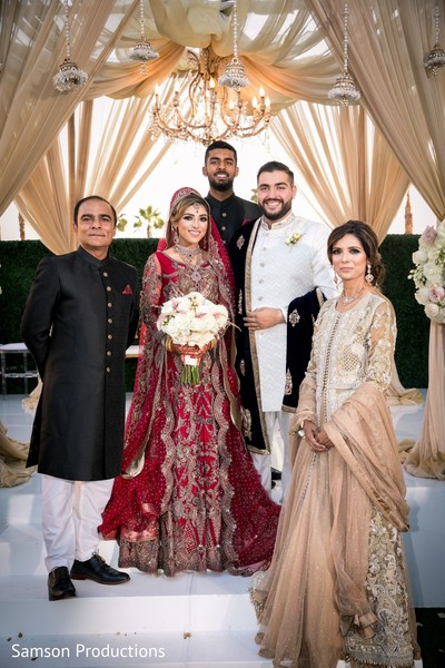 Indian newlyweds and Indian relatives on the wedding stage