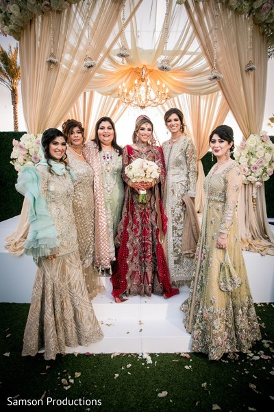 Maharani and her female Indian relatives on the wedding stage
