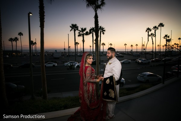 Indian newlyweds outdoors at sunset