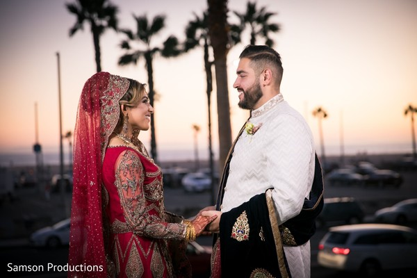 Indian newlywed couple sharing a moment at sunset