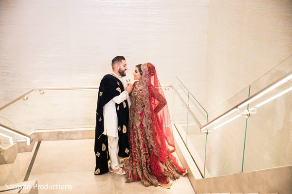 Indian newly wed couple stop to share a moment on the stairs