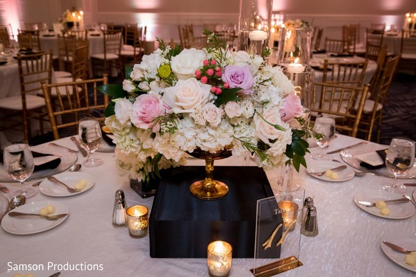 A small flower arrangement in the center of one of the tables