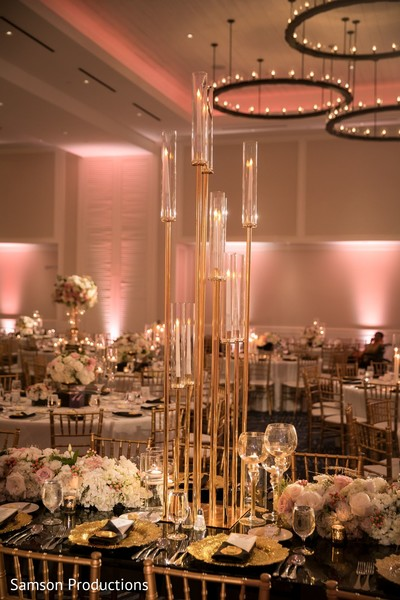 A tall candle decoration on one of the tables