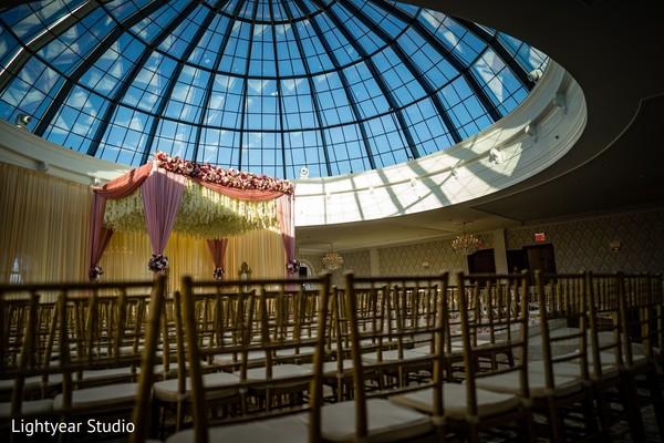 Hindu wedding ceremony under a dome.
