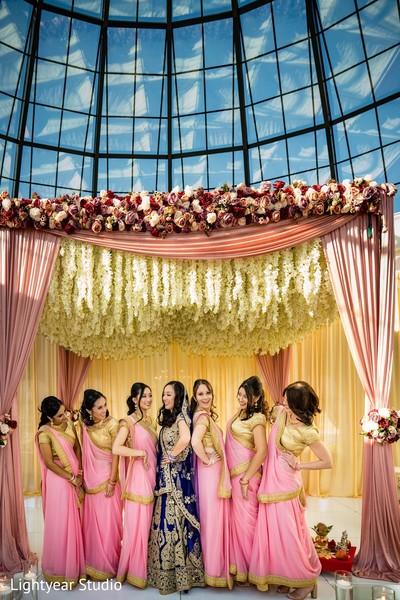 Indian bridesmaids in pink sarees.