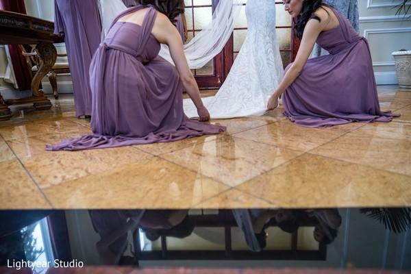 India bridesmaids helping a Maharani to get ready.