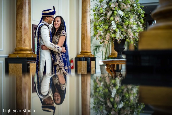 Indian bride and groom in blue and white outifits.