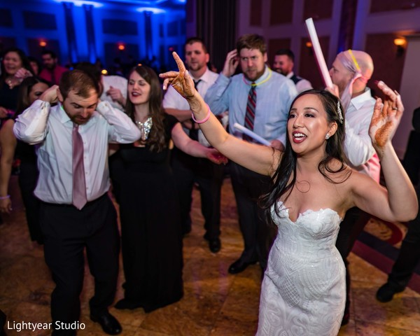 Indian bride dancing at reception party.
