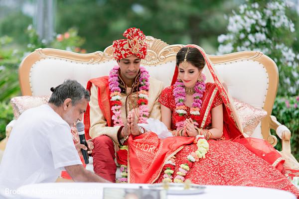 Indian couple praying during their hindu wedding.