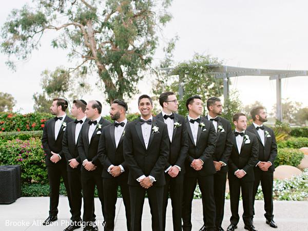 Indian groom and his groomsmen in black.