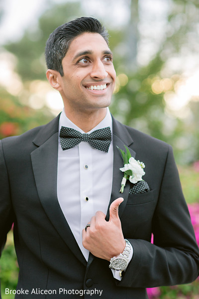 Indian groom posing with his tux.