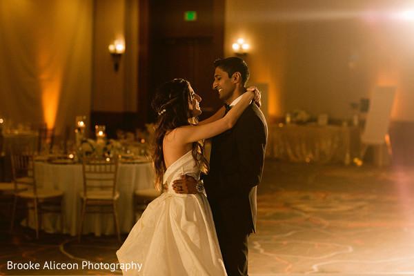 Maharani and Raja dancing close together during reception.