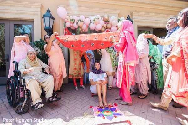 Maharani covered with antarpta at pre-wedding ritual.