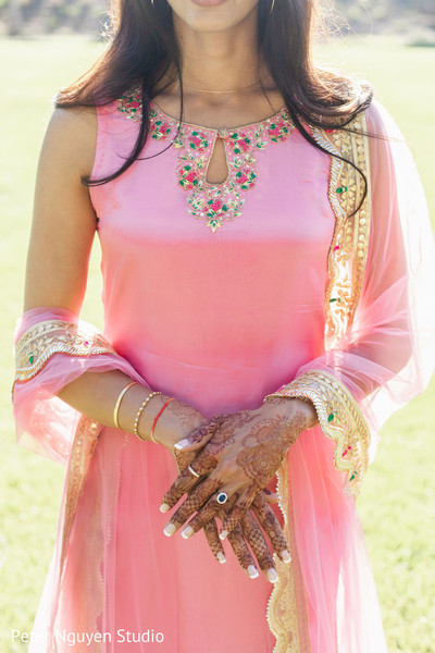 Indian bride showing her henna art and her engagement ring.