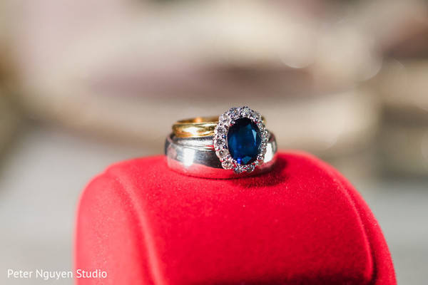 White gold wedding bands and bridal blue stone engagement ring.