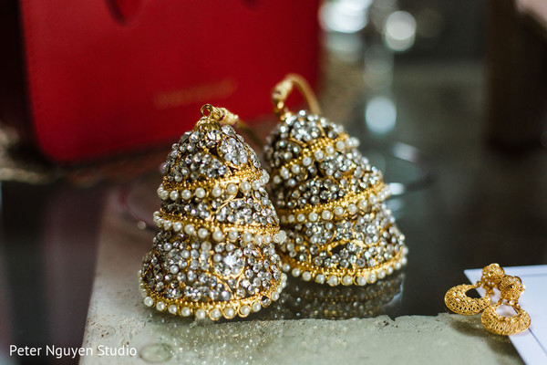 Yellow gold, pearls and diamonds bangles with hanging bells.