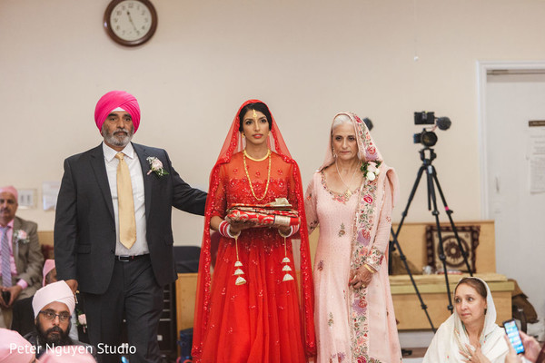 Maharani making her big entrance with parents to wedding ceremony.