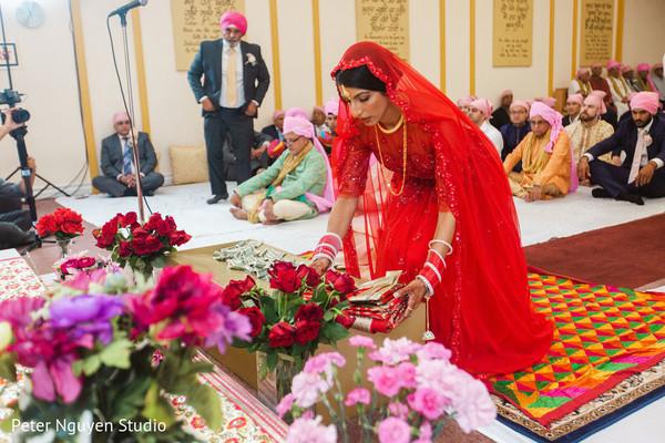 Indian bride arriving to wedding ceremony.