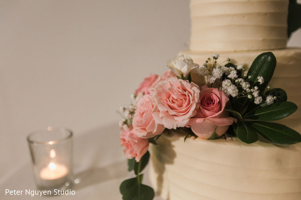 Indian wedding cake pink roses decoration.
