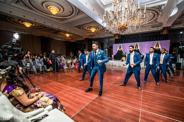 Indian groom and groomsmen performing a dance for indian bride.