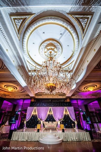 Indian wedding reception stage chandelier decoration.
