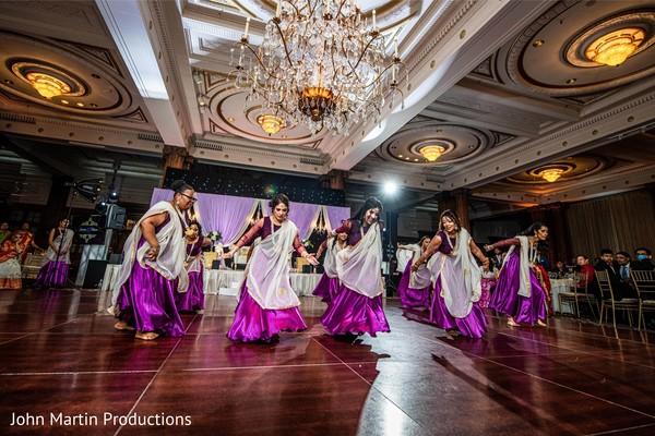 Indian bridesmaids dancing a choreography at reception.