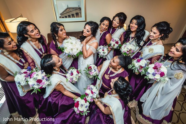 Indian bride ready with bridesmaids on their wedding dresses.