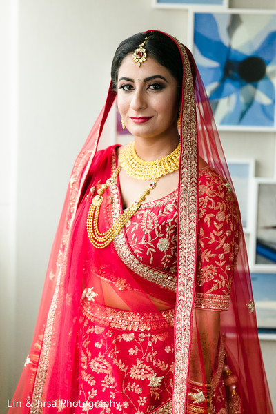 Maharani, in the traditional red and gold, before the ceremony