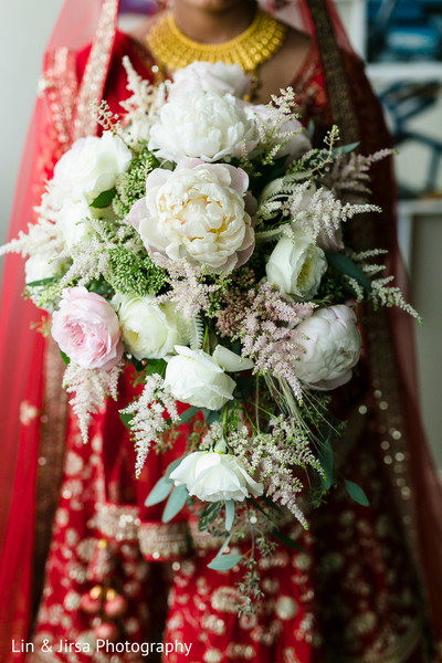 Indian bride holding her bridal bouquet